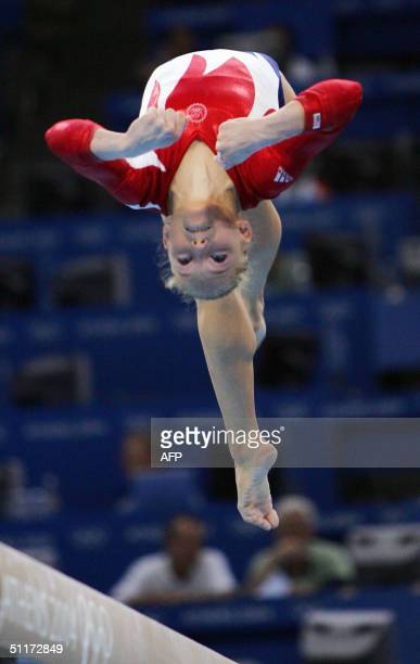 Courtney Mccool of the US performs on the beam during the Artistic Gymnastics qualifications 15 August 2004 at the Olympic Indoor Hall during the...