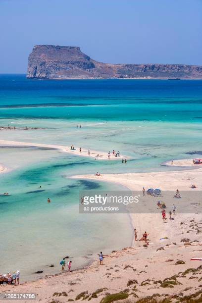 greece, crete, gramvoussa peninsula, balos, people on beach and turquoise sea - greece stock pictures, royalty-free photos & images