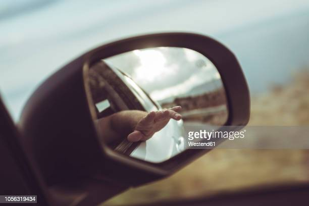 greece, crete, hand in rear-view mirror of a car - rear view mirror stock pictures, royalty-free photos & images