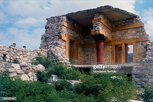 Greece Crete Knossos Detail Detail of the ruins of the palace of Minos with the characteristic ocher eaves and red column with black capital