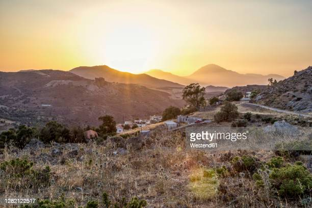 greece, crete, lentas, mountain village at summer sunset - 山村 ストックフォトと画像