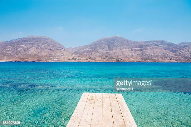 Greece, Cyclades, Amorgos, Nikouria island, wooden jetty and Aegean Sea