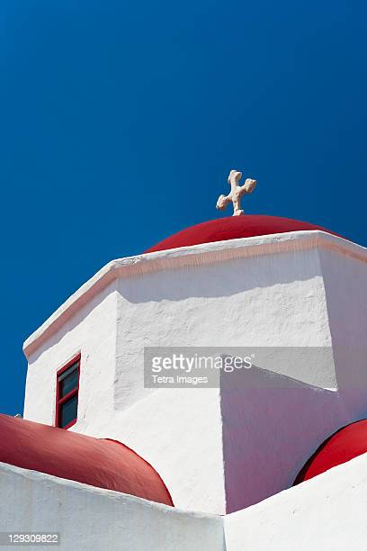 Greece, Cyclades Islands, Mykonos, Church roof with cross