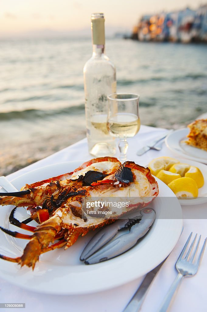 Greece, Cyclades Islands, Mykonos, Lobser dinner at coast : Stock Photo