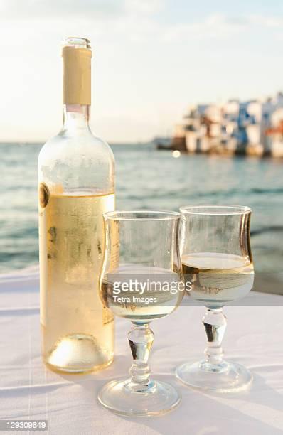 Greece, Cyclades Islands, Mykonos, Wine on table by sea