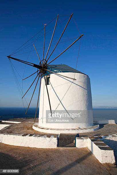 Greece Cyclades Islands Sifnos Island Artemonas village Old wind mill which is now converted to accommodation on the top of a cliff