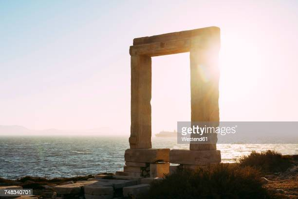 Greece, Cyclades, Naxos, Gate to the temple of Apollo at sunset