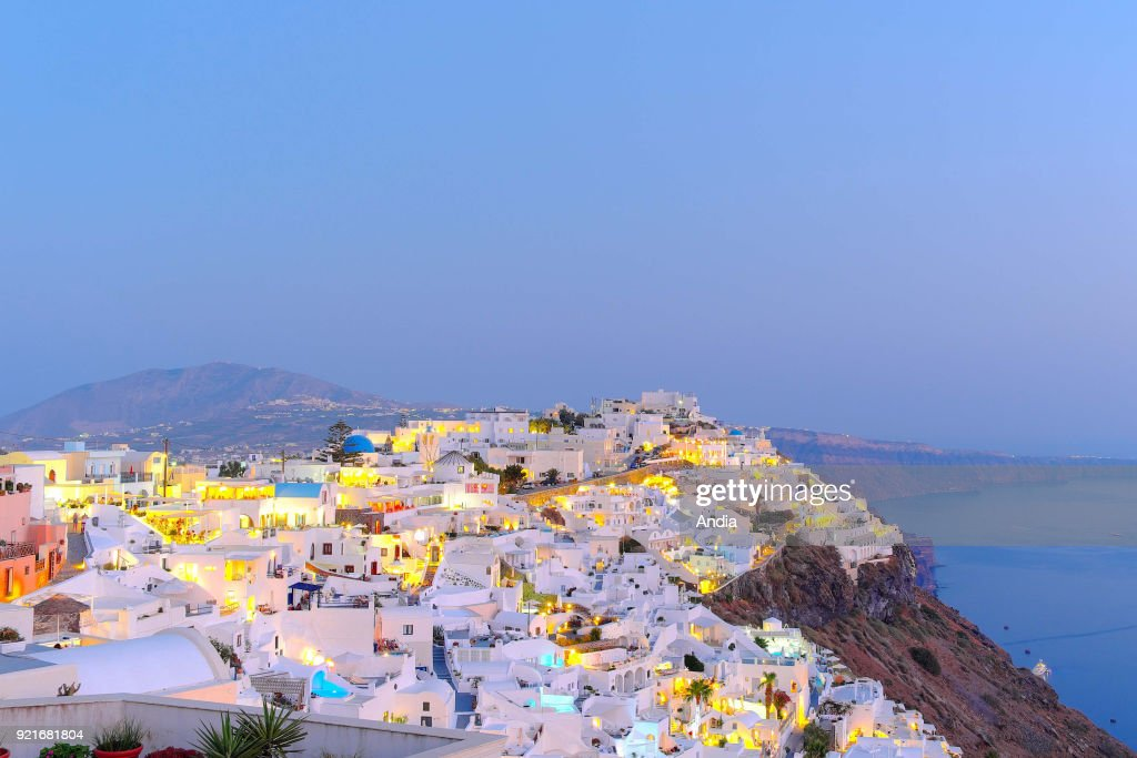 Greece, Cyclades, Santorini Island (also Thera or Thira): le village of Fira lit up at nightfall.
