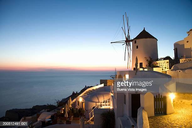 Greece, Cyclades, Santorini, Oia, street and windmill, dusk