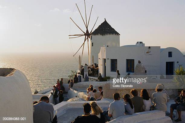 greece, cyclades, santorini, oia, windmill, sunset - oia santorini stock pictures, royalty-free photos & images