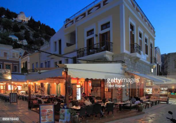 greece, dodecanese, symi, gialos, street scene, restaurant, - symi stock photos and pictures