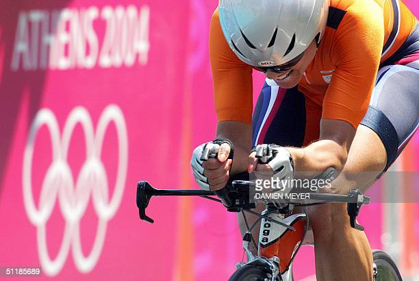 Dutch Leontien Zijlaard-van Moorsel rides towards the finish line and wins the women's individual time trial competition at the 2004 Olympic Games,...