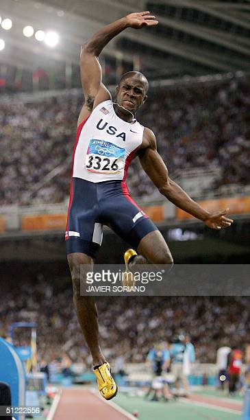 Dwight Phillips of the USA competes in the men's long jump final 26 August 2004 during the Olympic Games athletics competitions at the Olympic...