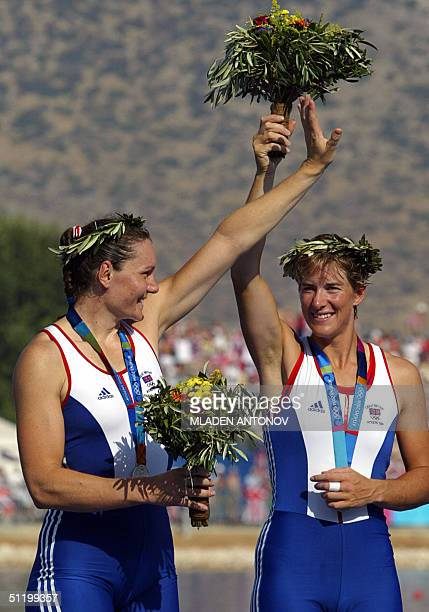 England's Katherine Grainger and Cath Bishop celebrate after receiving their silver medalsduring the Women's Pair final for the Athens 2004 Olympic...
