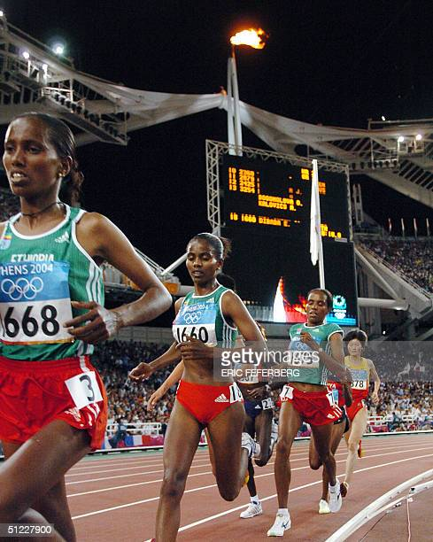 Ethiopia's Werknesh Kidane Ejegayehu Dibaba and Derartu Tulu compete in the women's 10000m final at the Olympic Stadium 27 August 2004 during the...