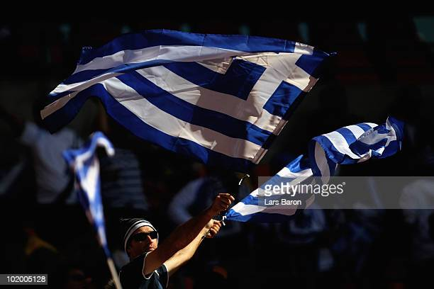 Greece fan waves flags prior to the 2010 FIFA World Cup South Africa Group B match between South Korea and Greece at Nelson Mandela Bay Stadium on...