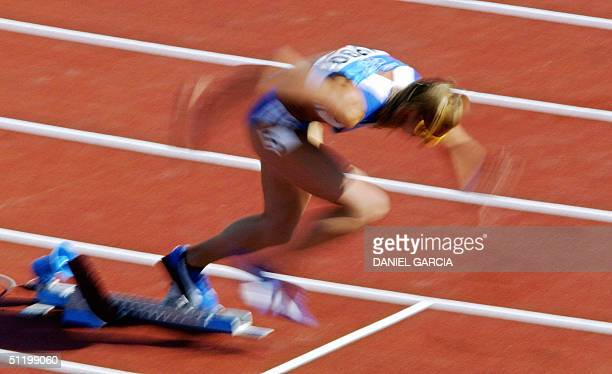 Fani Halkia of Greece competes in heat four round one of the women's 400m hurdles 21 August 2004 during the Olympic Games athletics competitions at...