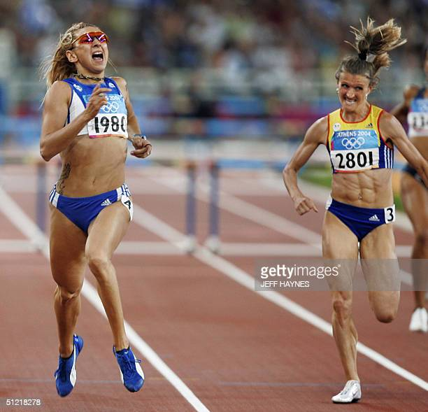 Fani Halkia of Greece finishes first ahed of Ionela TirleaManolache of Romania in the women's 400m hurdles final 25 August 2004 during the Olympic...
