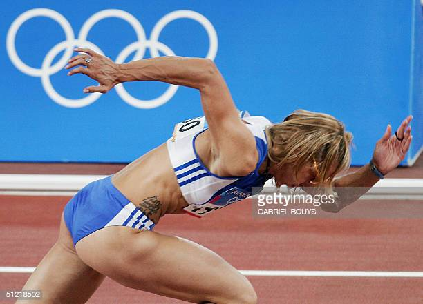 Fani Halkia of Greece heads to the finish first to win gold in the women's 400m hurdles final 25 August 2004 during the Olympic Games athletics...