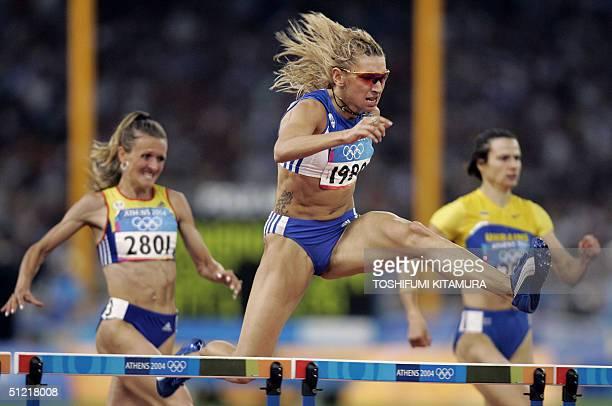 Fani Halkia of Greece wins ahead of Ionela TirleaManolache of Romania and Tetiana TereshchukAntipova of Ukraine 25 August 2004 during the Olympic...