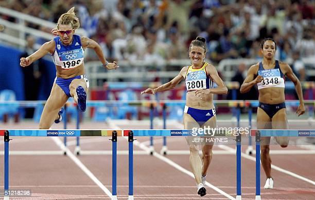 Fani Halkia of Greece wins ahead of Tetiana TereshchukAntipova of Ukraine and Brenda Taylor of the USA in the women's 400m hurdles final 25 August...
