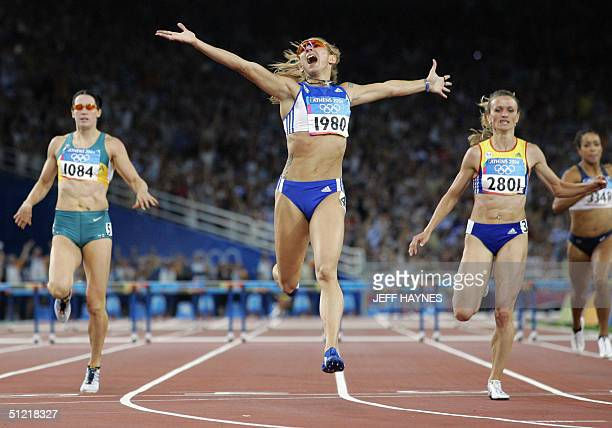 Fani Halkia of Greece wins ahead of Tetiana TereshchukAntipova of Ukraine Jana Pittman of Australia and Brenda Taylor of the USA in the women's 400m...