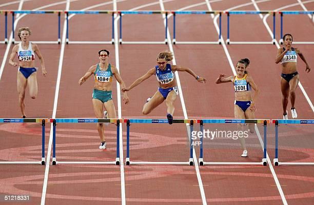 Fani Halkia of Greece wins ahead of Yuliya Pechenkina of Russia Jana Pittman of Australia Ionela TirleaManolache of Romania and Brenda Taylor of the...