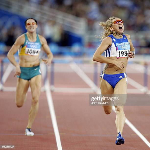 Fani Halkia of Greece wins ahed of Jana Pittman of Australia in the women's 400m hurdles final 25 August 2004 during the Olympic Games athletics...