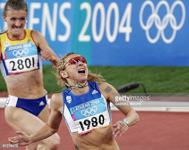 Fani Halkia of Greece wins Ionela TirleaManolache of Romania in the women's 400m hurdles final 25 August 2004 during the Olympic Games athletics...