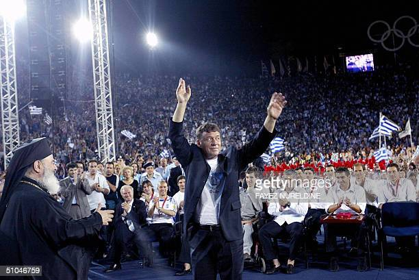 FILES Picture taken 05 July 2004 shows Greece's German coach Otto Rehhagel saluting the fans at the team's official homecoming ceremony in the...