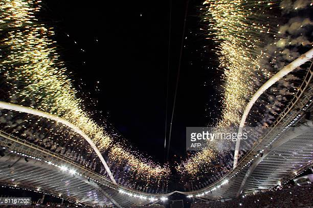 Fireworks explode above the Olympic Stadium during the opening ceremony of the XXVIII Olympic Games 13 August 2004 in Athens Some 10000 athletes...
