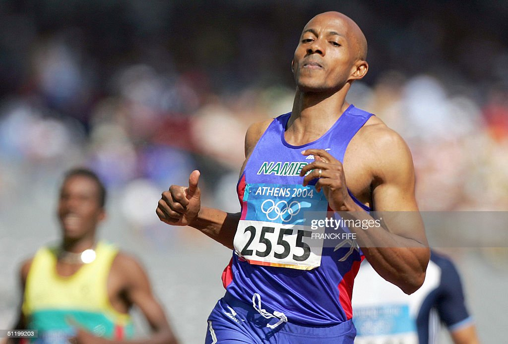 Frank Fredericks of Namibia wins heat one, round one of the men's 100m race, 21 August 2004, during the Olympic Games athletics competitions at the Olympic Stadium in Athens.Fredericks , Suetsugu and Emedolu qualified.