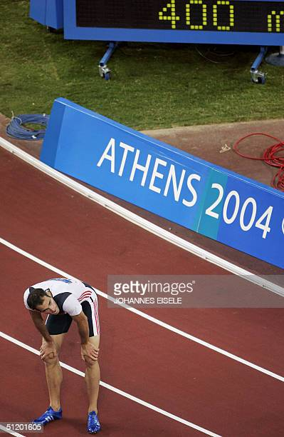 German Ingo Schultz waits fo the results in the men's 400m semifinals 21 August 2004 during the Olympic Games athletics competitions at the Olympic...
