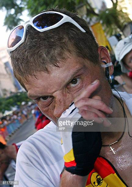German Jan Ullrich reacts after the men's road race at the Olympic Summer Games, 14 August 2004 in Athens. Italian Paolo Bettini won the event ahead...