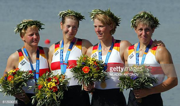 German Kathrin Boron Meike Evers Manuela Lutze and Kerstin El Qalqili celebrate on the podium after winning the gold medal in the women's quadruple...