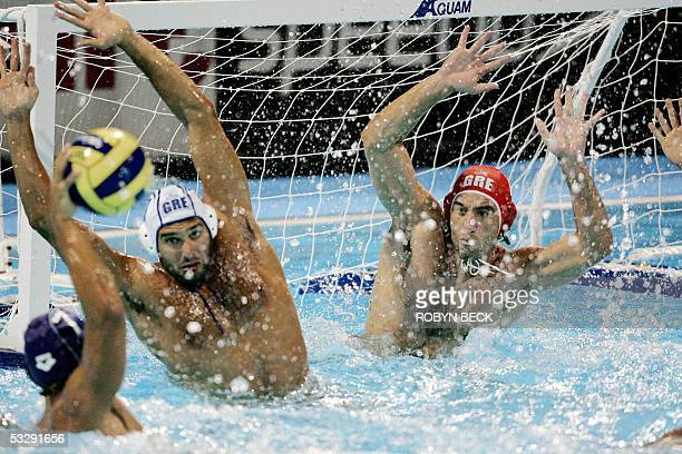 Greece goalkeeper Gerogios Reppas blocks a shot from Italy 26 July 2005 at the XI FINA Swimming World Championships at Parc JeanDrapeau in Montreal...