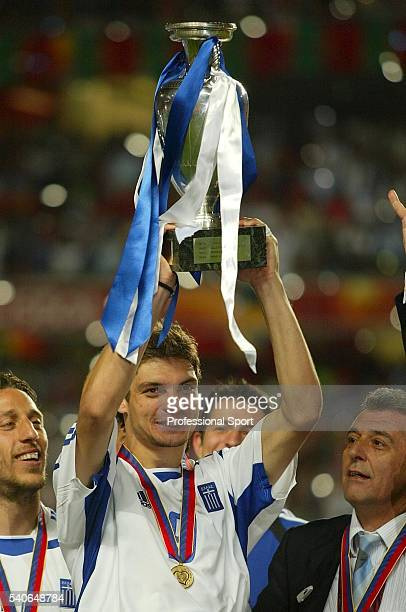 Greece goalscorer Angelos Charisteas lifts the trophy after securing a 10 win over Portugal during the UEFA Euro 2004 Final match between Portugal...