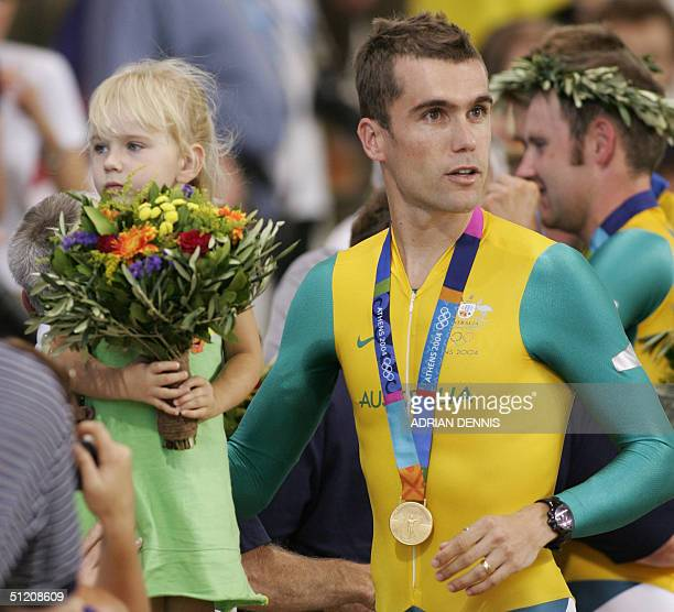 Gold medalllist Australian Bradley McGee celebrates his team's victory with his daughter Tahlia at the end of the men's team pursuit finals at the...