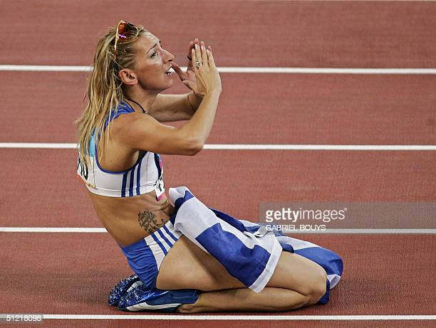 Greece's Fani Halkia celebrates after winning the gold medal in the women's 400m hurdles at the Olympic Stadium 25 August 2004 during the Olympic...