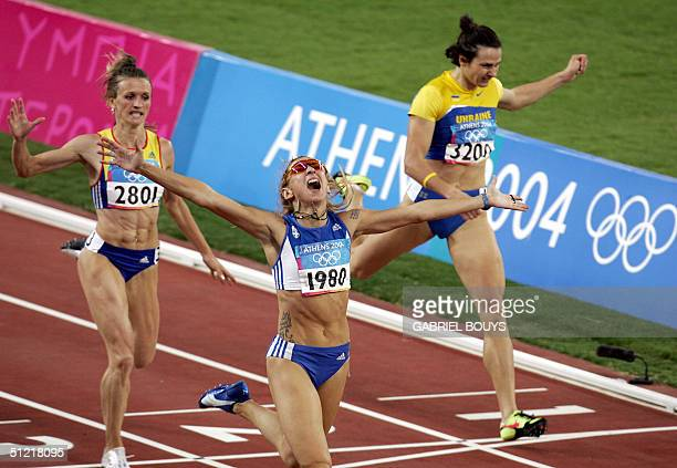 Greece's Fani Halkia celebrates as she wins the women's 400m hurdles at the Olympic Stadium 25 August 2004 during the Olympic Games athletics...