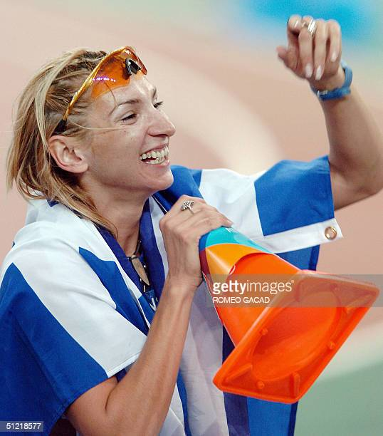 Greece's Fani Halkia jokes during a lap of honour after winning the women's 400m hurdles at the Olympic Stadium 25 August 2004 during the Olympic...
