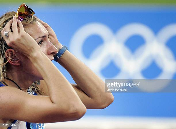 Greece's Fani Halkia reacts after winning the women's 400m hurdles at the Olympic Stadium 25 August 2004 during the Olympic Games athletics...
