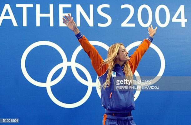 Inge de Bruijn from Netherlands poses on the podium after winning the women's 50m freestyle gold medal 21 August 2004 at the Olympic aquatic center...