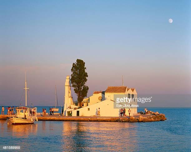 Greece Ionian Islands Corfu Kanoni south of Corfu Town Vlacherna Monastery Boat taking visitors to islet site of seventeenth century monastery
