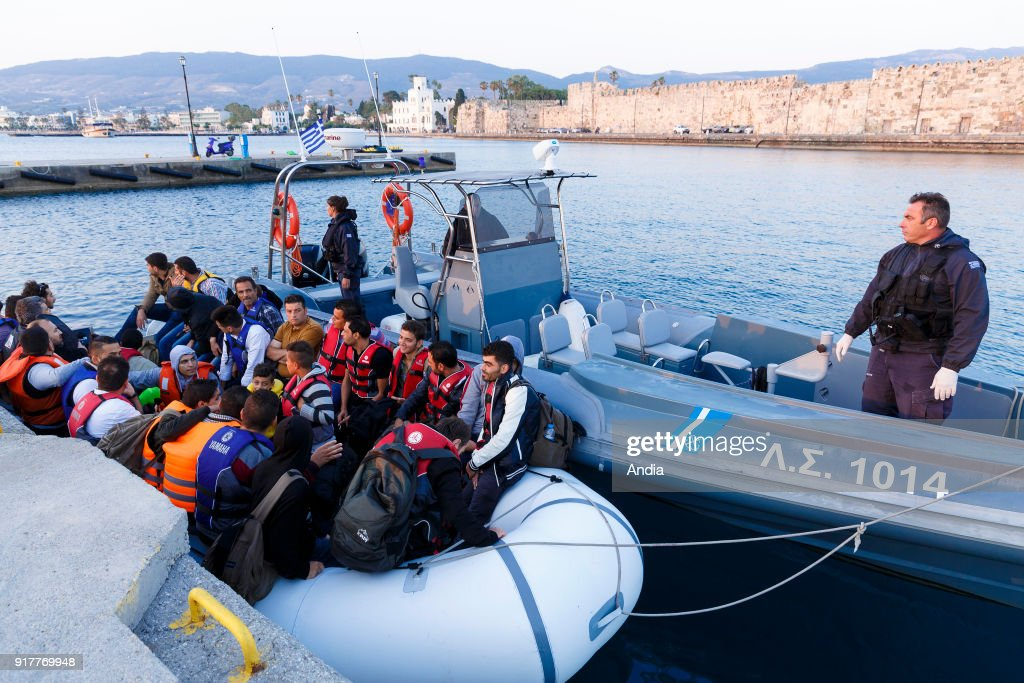 Greece, island of Kos, on . Coastguards towing an inflatable boat with migrants, mainly from Syria arriving on the island of Kos, from Turkey. The island of Kos is only 4 km away from Turkey and is an interim location for migrants mainly coming from Afghanistan and Syria.