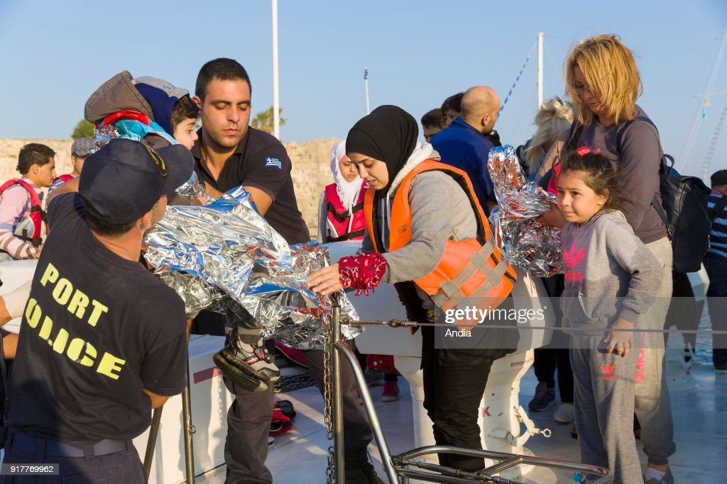 Greece, island of Kos, on . Migrants, mainly from Syria arriving on the island of Kos, from Turkey, on a boat with coastguards. The island of Kos is only 4 km away from Turkey and is an interim location for migrants mainly coming from Afghanistan and Syria.