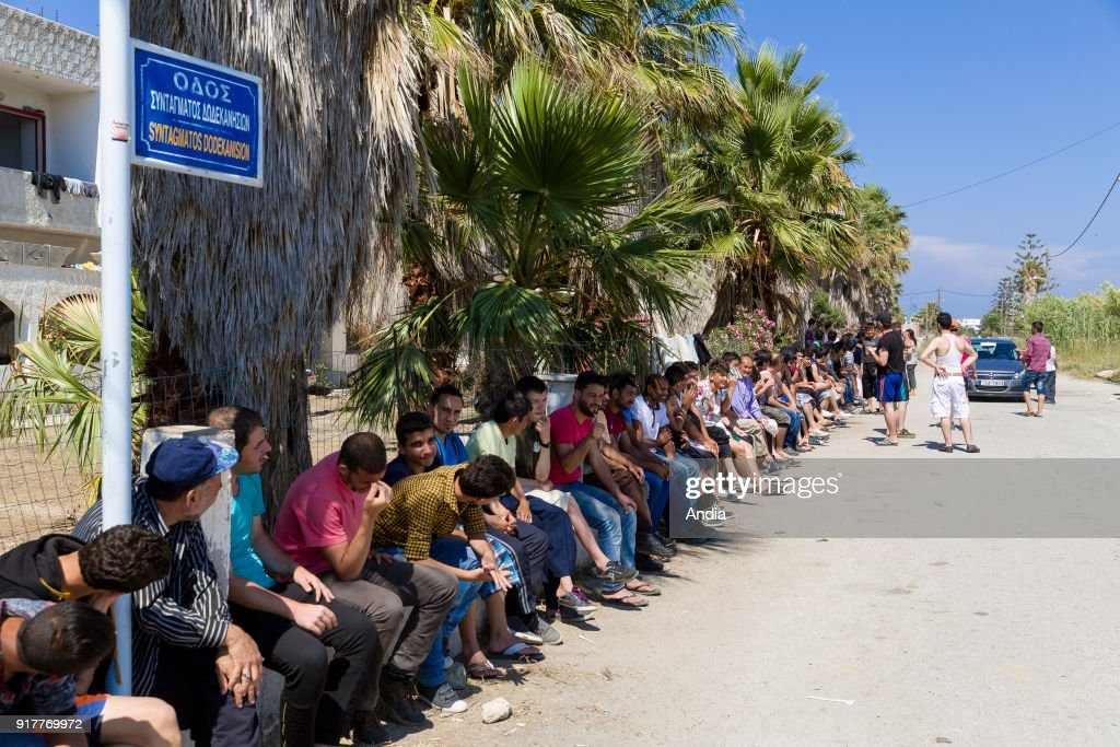Greece, island of Kos, on . Migrants waiting for people to give us food in front of the abandoned 'Captain Elias' hotel, now the refuge of hundreds of immigrants. The island of Kos is only 4 km away from Turkey and is an interim location for migrants mainly coming from Afghanistan and Syria.