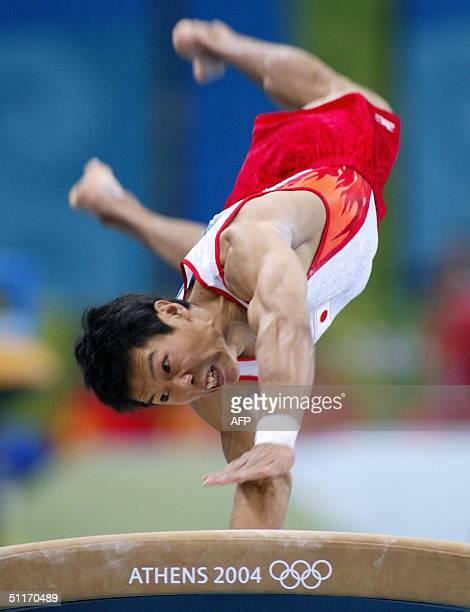 Japanese Hisashi Mizutori performs on the vault 14 August 2004 at the Olympic Indoor Hall during the men's gymnastics artistic qualification of the...