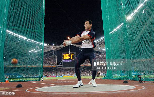Japanese Koji Murofushi competes during the men's hammer throw final at the Olympic Stadium 22 August 2004 during the Olympic Games in Athens. Adrian...