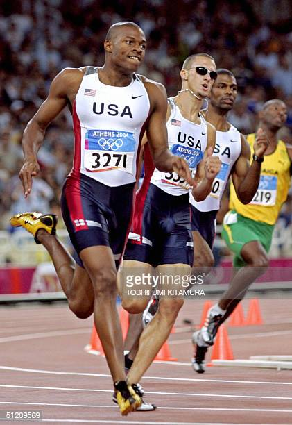 Jeremy Wariner of the USA , compatriots Derrick Brew and Otis Harris , and Jamaican Micahel Blackwood compete in the men's 400m final, 23 August...